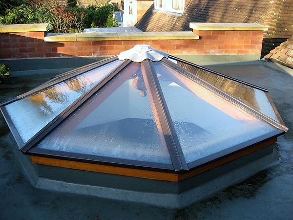 Idigbo lantern rooflight with aluminium caps
