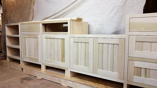 Kitchen units in Tulip Wood under construction in our workshop