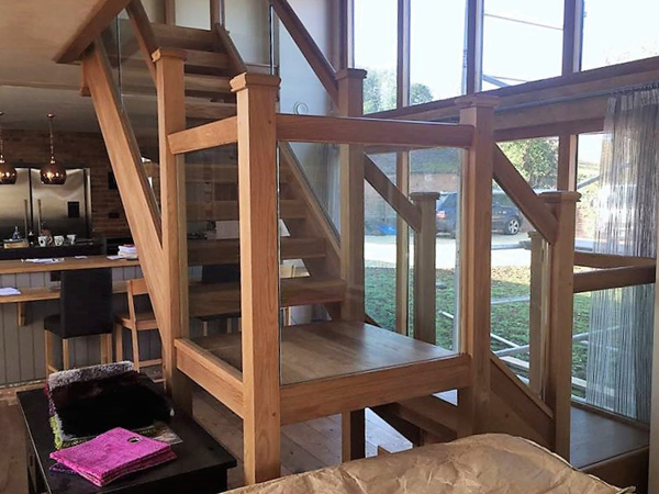 Oak open riser staircase with glass balustrade Stratford Upon Avon Warwickshire
